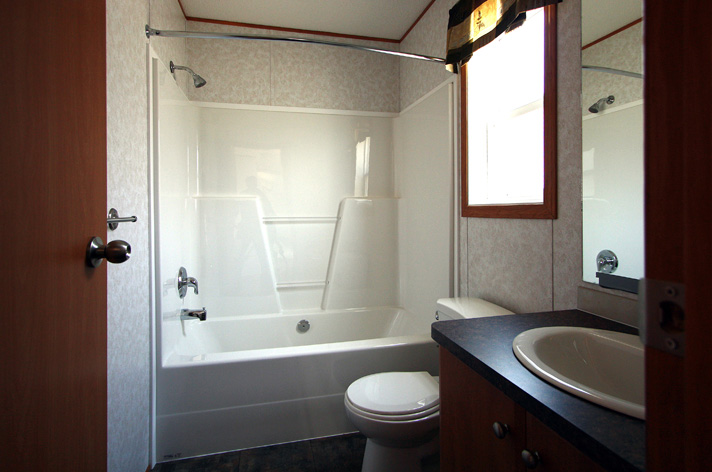 Main bathroom with one piece tub-shower.