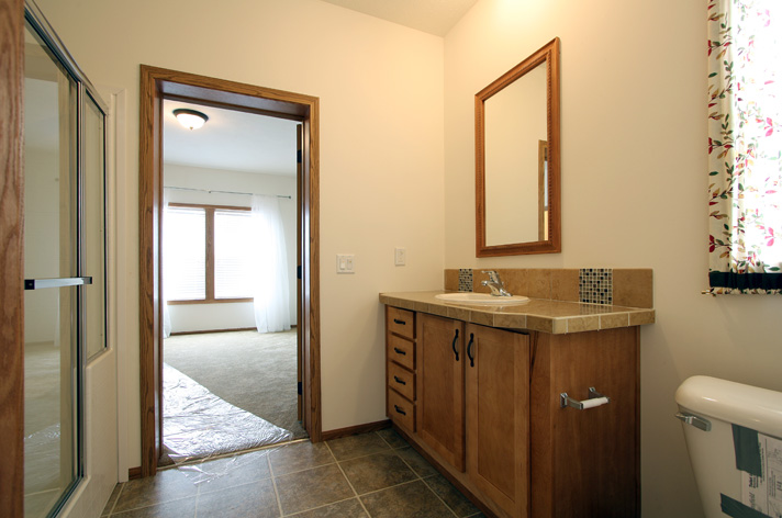 Ensuite bath from standing in the laundry room doorway