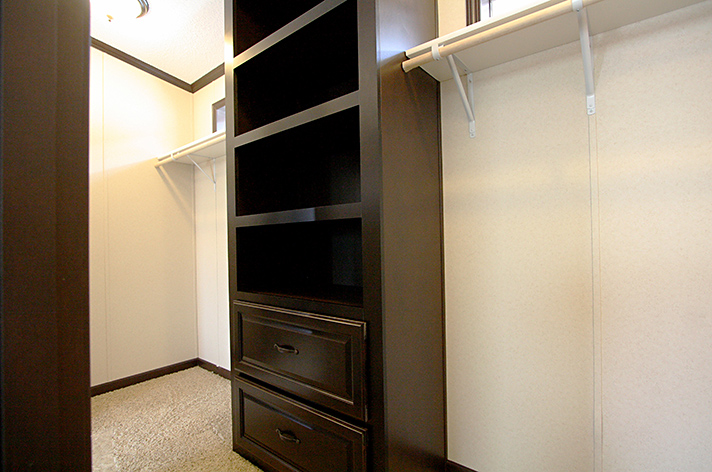 Giant closet with built in shelving and drawers